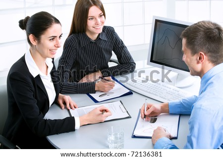 Image of successful partners discussing business plan at meeting