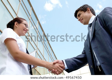 Image of successful partners handshaking after striking deal - stock photo