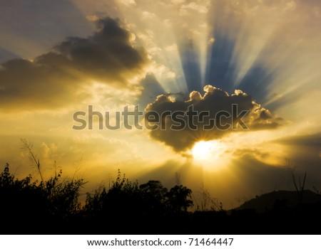 Image of sun shine through rain cloud - stock photo