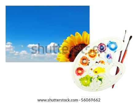 Image of sunflower with picturesque cloudy blue sky on a piece of paper with palette and paintbrushes - stock photo