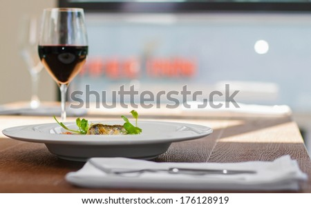 Image of tasty fish served in restaurant