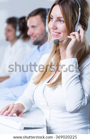 Image of team of telemarketers working in call center - stock photo