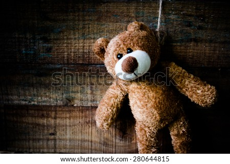 Image of teddy bear  is committing suicide by hanging itself despair concept,Still life - stock photo