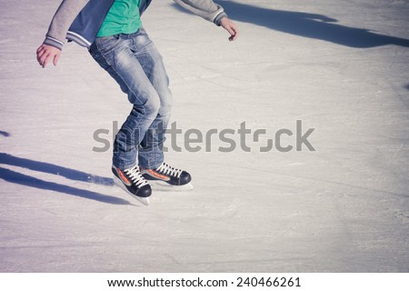 Image of teenager who are ice skating in the ice rink at the Medeo - stock photo