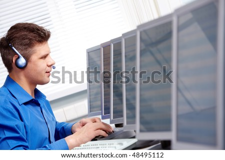 Image of telephone operator working in the computer class - stock photo