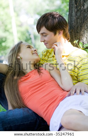 Image of tender woman touching her boyfriend face while spending time together - stock photo