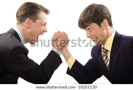 Image of tense businessmen trying to cope with each other in struggle - stock photo