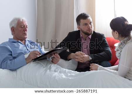 Image of terminally ill father making a will - stock photo