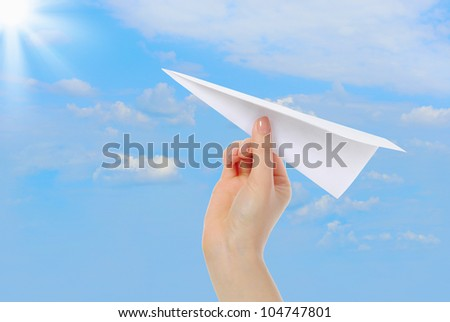 image of the businesswoman throwing white paper plane. - stock photo