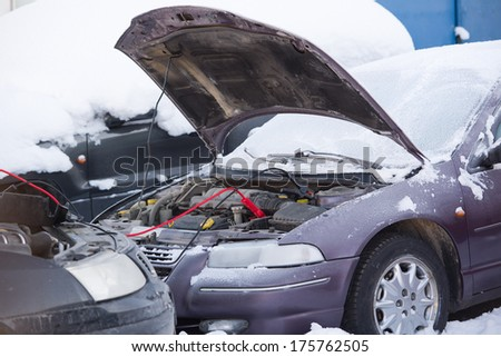 Image of the car strats with jumpers - stock photo