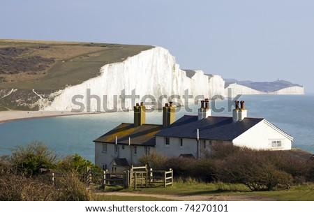 Image of the Coast Guard Cottages & Seven Sisters just outside Eastbourne, England - stock photo