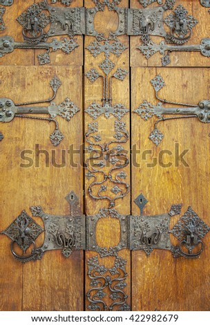 Image of the door of a vintage, medieval cupboard. - stock photo