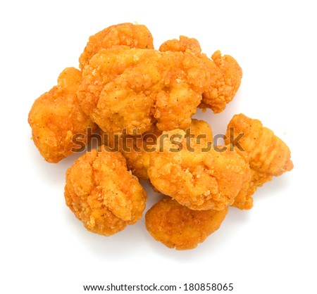 image of the fried Popcorn chicken on a white background. - stock photo