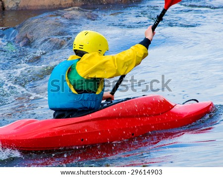 image of the kayaker with an oar on the water - stock photo
