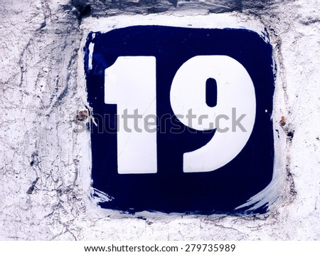 Image of the number 19 on a wall indicating a house number - stock photo