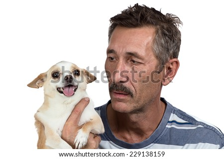 Image of the old man holding the dog
