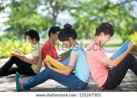 Image of the students busy with reading their notes - stock photo