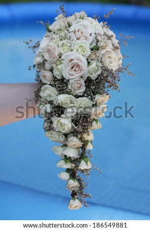 image of the Wedding bouquet of white roses in front of blue background , wedding bouquet - stock photo