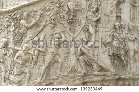 image of theTrajan's Column (in Italian: Colonna Traiana).It is a Roman triumphal column in Rome, Italy, that commemorates Roman emperor Trajan's victory in the Dacian Wars. - stock photo