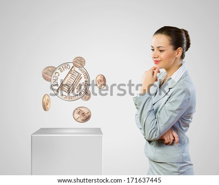 Image of thoughtful businesswoman with cent coin. Currency concept - stock photo