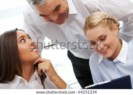 Image of three business people discussing documents or plan - stock photo