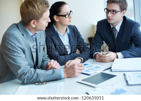 Image of three business people negotiating at meeting - stock photo