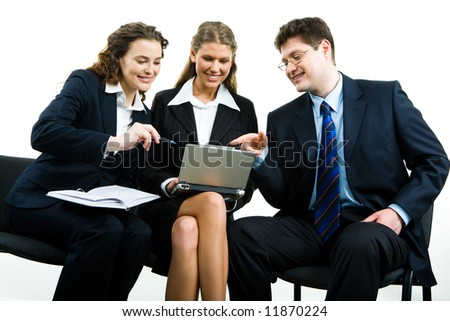 Image of three business people sitting on the chairs and discussing