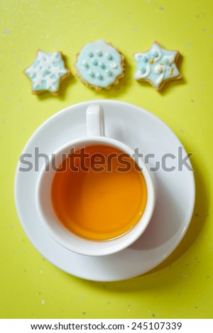 Image of three ginger cookies and cup of tea - stock photo