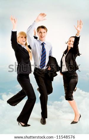 Image of three joyful business people on the background of sky - stock photo