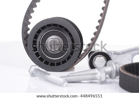Image of Timing belt, roller,bolts against white background - stock photo
