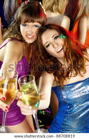 Image of toasting friends clinking glasses with champagne at party - stock photo