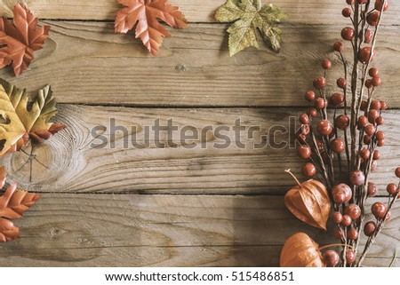 Image of top view mockup scene with wooden background and autumn plants.