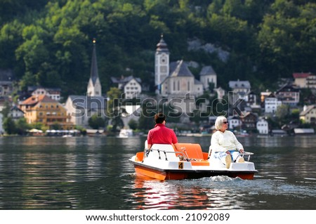 image of tourists on pedal boat at Hallstatt, Austria - stock photo