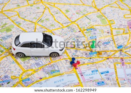 Image of travel concept. small car on London city map - stock photo