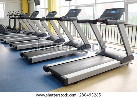 image of treadmills in a fitness hall - stock photo