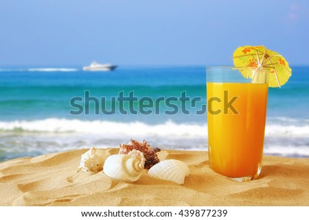 Image of tropical sandy beach, fruit cocktail and seashells. Summer concept - stock photo