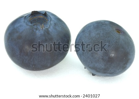 Image of two blueberries placed on white background