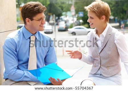 Image of two business partners interacting and planning work - stock photo