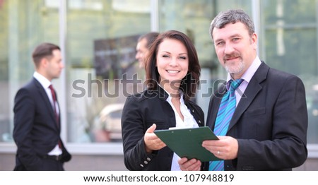 Image of two business partners planning work outdoors - stock photo