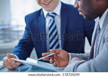 Image of two businessmen discussing computer project - stock photo