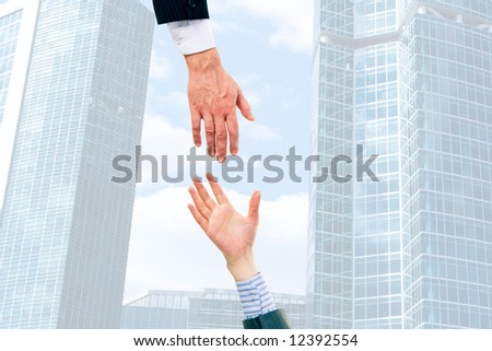 Image of two businesspeople giving hands each other - stock photo