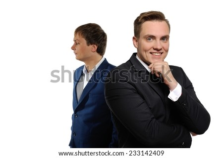 Image of two elegant businessmen. One of them looking at the camera, the other to the left.