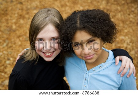 image of two friends of different ethnicities - stock photo