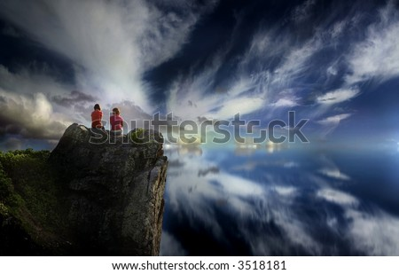 Image of two girls on a mountain top - stock photo