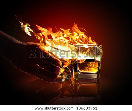 Image of two glasses of burning yellow absinthe - stock photo