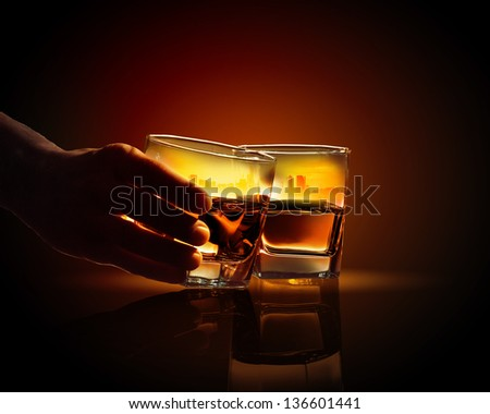 Image of two glasses of whiskey with city illustration in - stock photo