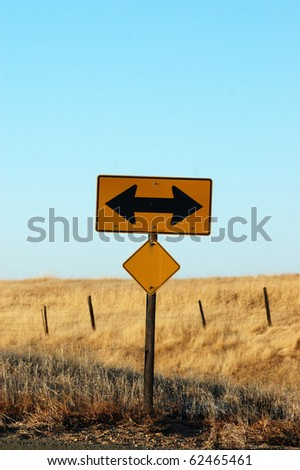 Image of two way sign with country side in background - stock photo