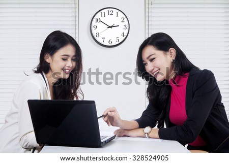 Image of two young businesswoman using laptop computer in the business meeting - stock photo