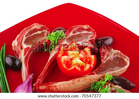 image of uncooked ribs served on red