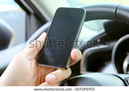 image of using a mobile phone inside of a car  - stock photo